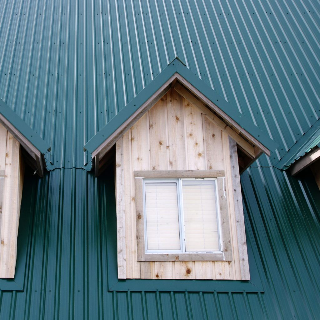 Green metal roof and eaves.