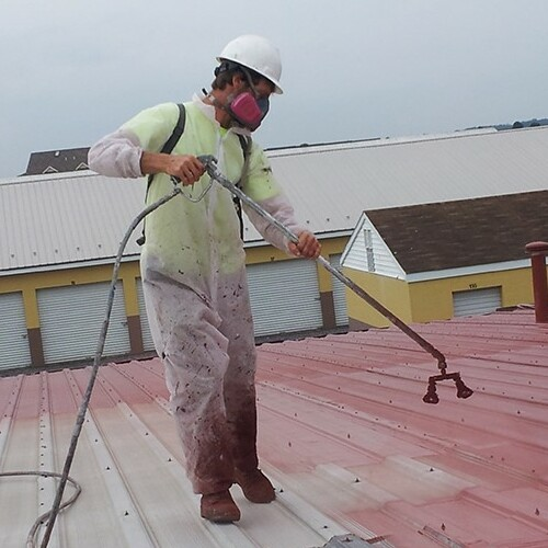 A Contractor Applies a Roof Coating.