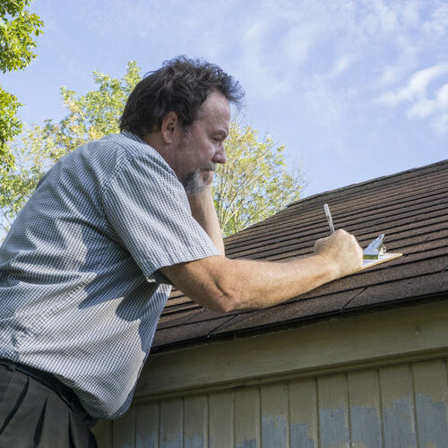 Adjuster Completing Roof Inspection