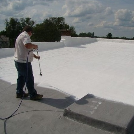 A Roofer Applies Flat Roof Coating.